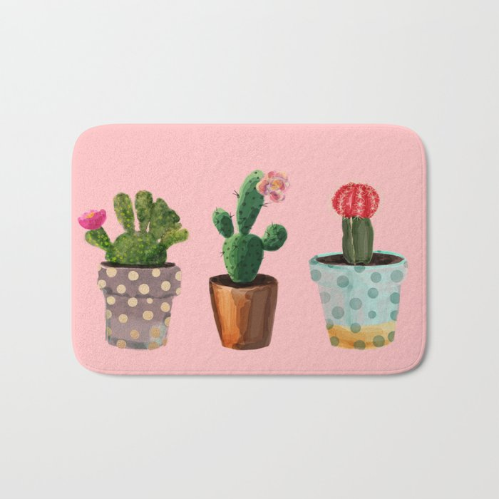 Three Cacti With Flowers On Pink Background Bath Mat