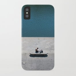 The reader and the river iPhone Case