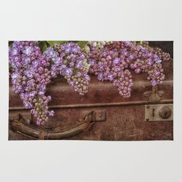 Vacation in the spring- lilac and vintage suitcase Rug