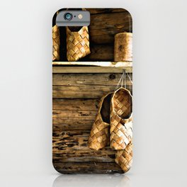 Medieval Bast Shoes On The Wooden Wall iPhone Case