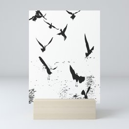 Silhouette Of A Flock Of Seagulls Over Water Vector Mini Art Print