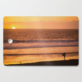 Surfer watching sunset in Southern California Cutting Board