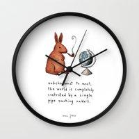 smoking Wall Clocks featuring Pipe-smoking rabbit by Marc Johns