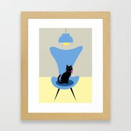 Cat on a sofa in blue Framed Art Print