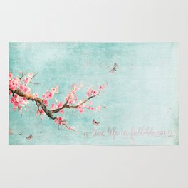 Live life in full bloom - Romantic Spring Cherry Blossom butterfly Watercolor illustration on aqua Rug