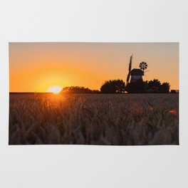 North German windmill from old time in the sunset Rug