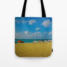 Colorful Boats Adorn the Tranquil Beach Tote Bag
