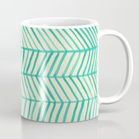 herringbone Mugs featuring Mint Herringbone by Cat Coquillette