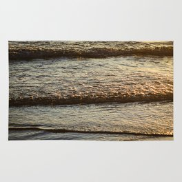 Sea waves background at sunset Rug