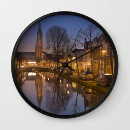 Church reflected in a canal in Delft, The Netherlands Wall Clock