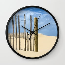 Fence in the sand Wall Clock