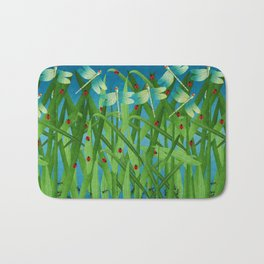in the grass Bath Mat