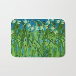 in the grass Bath Mat