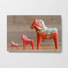Three Dala horses in different sizes in a row Metal Print