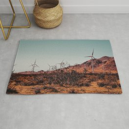 Wind turbine and desert view at Kern County California USA Rug