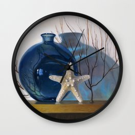 Still life with a blue vase and a starfish Wall Clock
