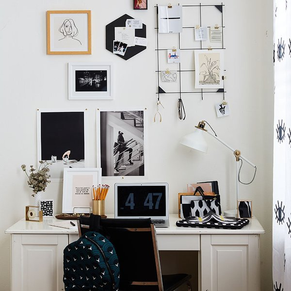 office with gallery wall of black and white prints