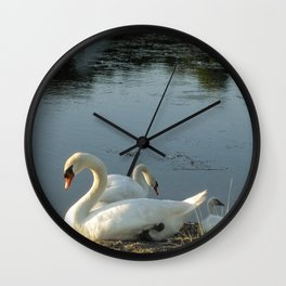 Parents and baby relaxing on the shore Wall Clock