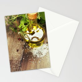 Olive oil,  herbs and spices on a wooden table Stationery Cards