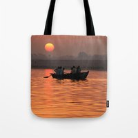 rowing Tote Bags featuring Rowing Boat on the Ganges at Sunrise by Serenity Photography