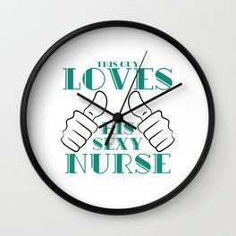 "Are you a Man who loves you sexy nurse? Here's a t-shirt saying ""This Guy Loves His Sexy Nurse"". Wall Clock"