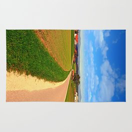 A road, a village and summer season | landscape photography Rug