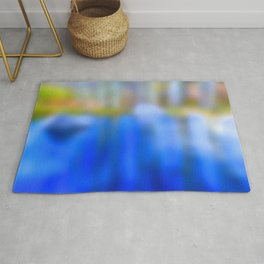 Reflections in blue and gold Rug