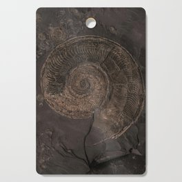Brown rock with shells Cutting Board