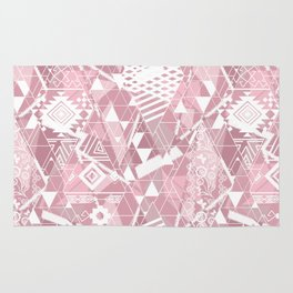 Abstract ethnic pattern in dusky pink, white colors. Rug