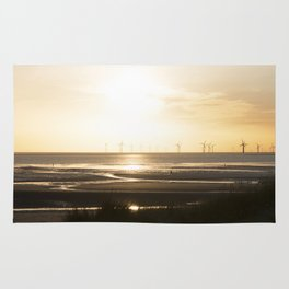 Sunset in Cosby beach Rug