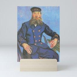 Vincent van Gogh - Portrait of Joseph Roulin sitting at a table (1888) Mini Art Print