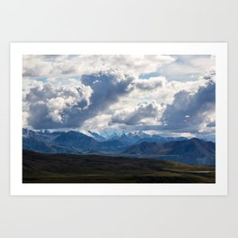 Denali peaking through the clouds Art Print