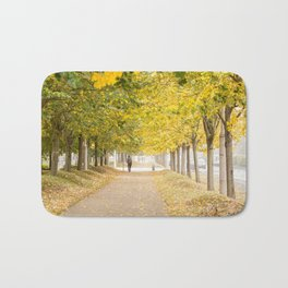 Walking under the trees in Autumn I Bath Mat