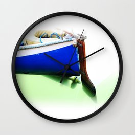 The fishing boat and the water Wall Clock