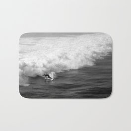 Lone Surfer in Black and White Bath Mat