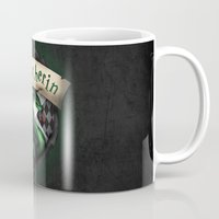 slytherin Mugs featuring Slytherin Crest by Sharayah Mitchell