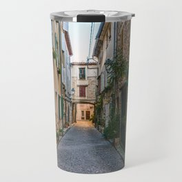Little alley in the medieval village of Antibes in a sunny winter day Travel Mug