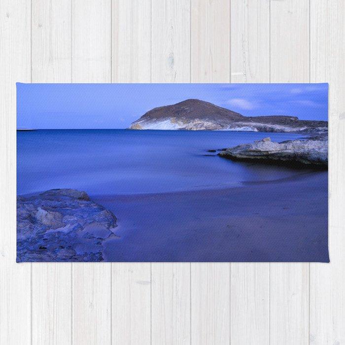 Blue sunset at Genoveses beach Rug