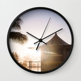 Sunset at the lifeguard tower Wall Clock