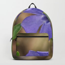 small blue flower in the forest Backpack