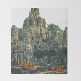 Unidentified Buddist monks from Thailand at one of the temple of Bayon Temple .Buddhism is currently Throw Blanket