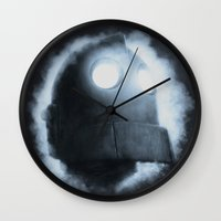 iron giant Wall Clocks featuring The Iron Giant Rises by Chuck Jackson
