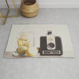 a vintage kodak brownie camera with delicious french macarons Rug