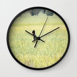 Man in the field Wall Clock