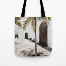 Palm tree growing in the street. La Palma, Canary Island. Tote Bag