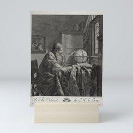 A scholar in his study, observing a globe (1784) Mini Art Print