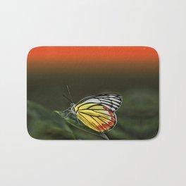 Butterfly Staring at Sunset Bath Mat