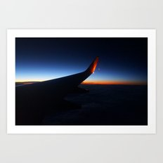 Flying over the west coast at sunset Art Print