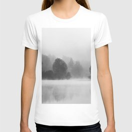 Trees disappearing in morning fog above the lake T-shirt