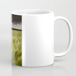 Stormy sky at sunset over field of barley. Coffee Mug